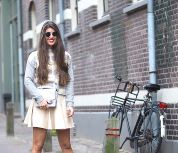 BARE LEGS AND KNITTED JUMPER